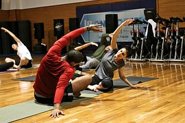 people stretching in a gym