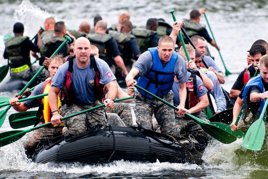 Men paddling riding on the boat